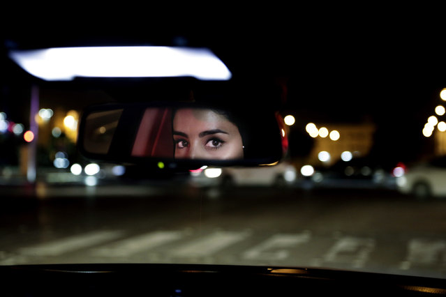 Hessah al-Ajaji drivers her car down the capital's busy Tahlia Street after midnight for the first time in Riyadh, Saudi Arabia, Sunday, June 24, 2018. Saudi women are in the driver's seat for the first time in their country and steering their way through busy city streets just minutes after the world's last remaining ban on women driving was lifted on Sunday. (Photo by Nariman El-Mofty/AP Photo)