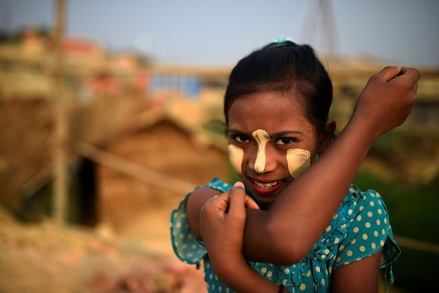 Rumana, 10. While it is used medicinally elsewhere in Asia, women in Myanmar also use it as a cosmetic. (Photo by Clodagh Kilcoyne/Reuters)