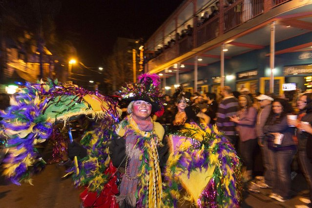 A woman in a feather dress marches in the Krewe du Vieux 2015 parade march, the first parade for the Mardi Gras festivities, through the French Quarter in New Orleans January 31, 2015. (Photo by Lee Celano/Reuters)