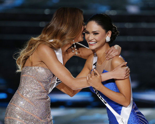 Miss Colombia Ariadna Gutierrez, left, and Miss Philippines Pia Alonzo Wurtzbach react as they make the final three at the Miss Universe pageant Sunday, December 20, 2015, in Las Vegas. (Photo by John Locher/AP Photo)