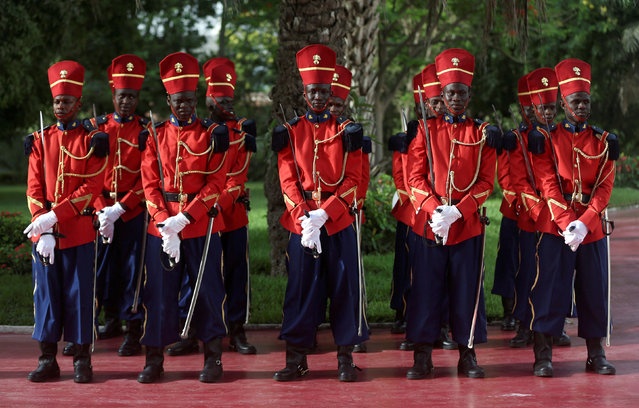 Senegalese guards stand outside the Presidential Palace prior to the arrival of Chinese President Xi Jinping during his visit to Dakar, Senegal July 21, 2018. (Photo by Mikal McAllister/Reuters)