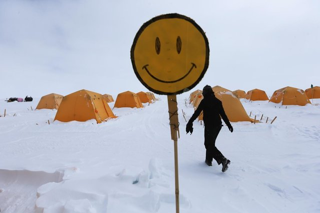 A happy face is seen near the tents where researchers live at Summit Station on July 11, 2013 on the Glacial Ice Sheet, Greenland. (Photo by Joe Raedle/Getty Images via The Atlantic)