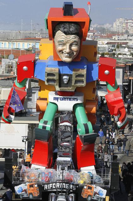 A float depicting Italian Premier Matteo Renzi is shown at the traditional Viareggio Carnival parade in Viareggio, Italy, Sunday, February 1, 2015. (Photo by Fabio Muzzi/AP Photo)