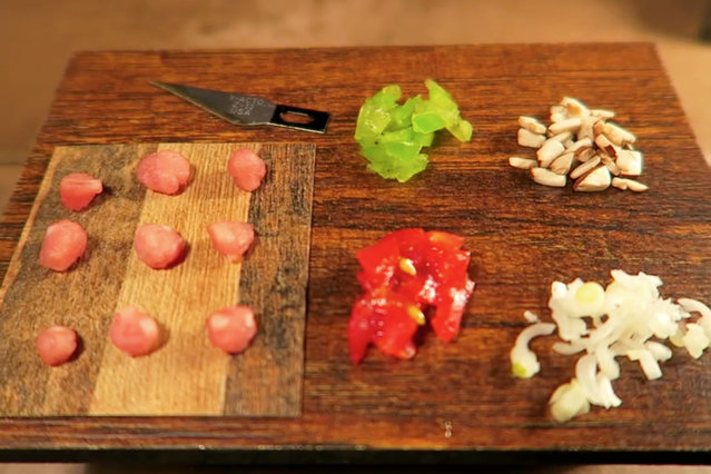 Jay chops the ingredients of the spaghetti on a tiny table. (Photo by Jay Baron/Caters News)