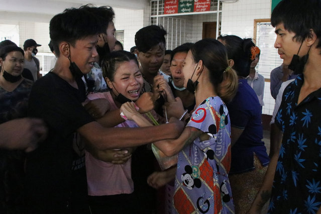 People mourn over the death of a man who was killed during a clash with Myanmar's security forces, during his cremation in Yangon, Myanmar, Monday, March 29, 2021. (Photo by AP Photo/Stringer)
