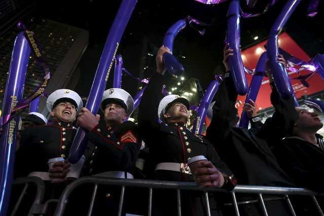 United States military members take part in festivities in Times Square during New Year's Eve celebrations in the Manhattan borough of New York, December 31, 2015. (Photo by Carlo Allegri/Reuters)