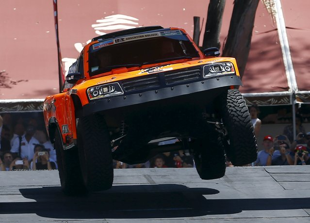 U.S. Robby Gordon powers his Gordini at the podium during the departure ceremony of the 38th Dakar Rally in Buenos Aires, Argentina, January 2, 2016. (Photo by Enrique Marcarian/Reuters)