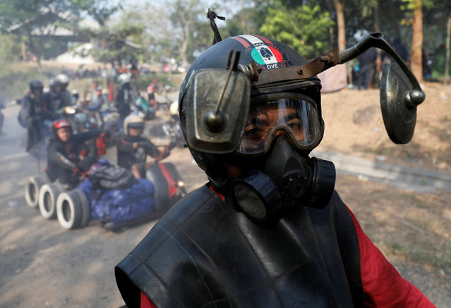 A rider wears a modified helmet and mask while attending a weekend festival for extreme Vespas in Semarang, Central Java, Indonesia, July 22, 2018. (Photo by Darren Whiteside/Reuters)