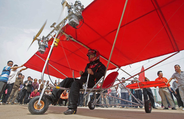 Farmer Shu Mansheng prepares to take off with his homemade ultralight aircraft in Wuhan, Hubei province May 10, 2010. The 4.5-meter-long (15ft) ultralight, powered by two motor engines, took Shu eight months to build and cost him 5,000 yuan (733 USD), local media reported. (Photo by Reuters/China Daily)
