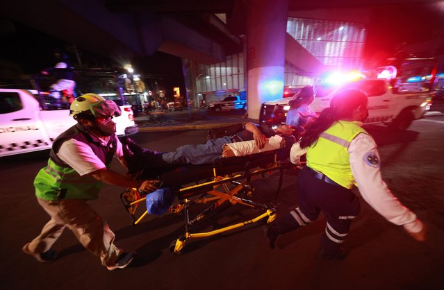 The injured are carried by stretcher after a raised subway track collapsed on May 03, 2021 in Mexico City, Mexico. The Line 12 accident happened between Olivos and Tezonco Metro stations. At least 15 people were killed and dozens injured as an elevated metro line collapsed in the Mexican capital on May 3 as a train was passing, authorities said. (Photo by Hector Vivas/Getty Images)