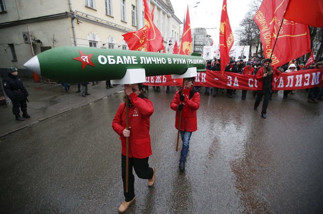 "Supporters and activists of the Russian Communist party take part in a procession to mark the Defender of the Fatherland Day in central Moscow February 23, 2015. The words on the model of an ammunition read, ""Privately to Obama (Rashkin)"". (Photo by Maxim Zmeyev/Reuters)"