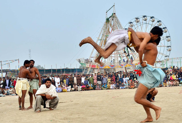 Wrestlers in action during a traditional Sindhi wrestling match of Malakhra on the occasion of the annual Urs of Hazrat Girghal Shah Bukhari in Naundero, Pakistan on January 7, 2016. (Photo by  Asianet-Pakista/Barcroft India)