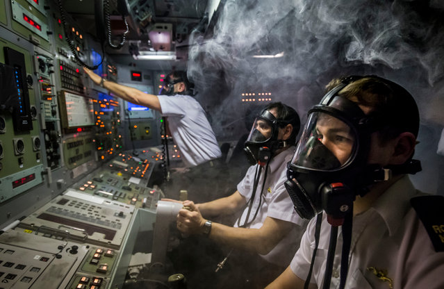 Members of the Royal Navy respond to a simulated fire in a Vanguard-class submarine control room training facility at Clyde naval base in Faslane, Scotland on January 21, 2016. (Photo by Photograph: Danny Lawson/PA Wire)