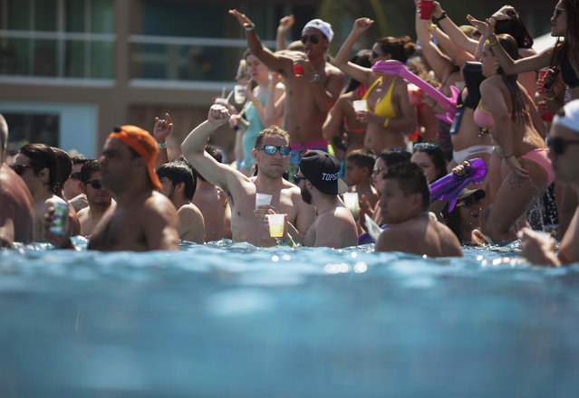 Spring breakers gather at a pool party at a hotel in Cancun March 8, 2015. (Photo by Victor Ruiz Garcia/Reuters)