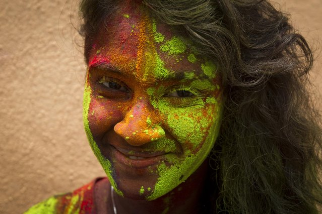 A Malaysian-Indian woman poses for a photo during the religious spring festival Holi in Kuala Lumpur, Malaysia on Saturday, March 21, 2015. (Photo by Joshua Paul/AP Photo)