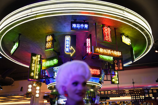 People attend a party during the the opening night of the Resorts World Las Vegas hotel-casino, Thursday, June 24, 2021, in Las Vegas. (Photo by John Locher/AP Photo)