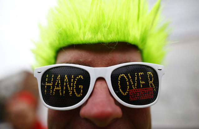 """A reveller takes part in the traditional """"Weiberfastnacht"""" (Women's Carnival) celebration in Mainz, Germany, February 4, 2016. (Photo by Kai Pfaffenbach/Reuters)"""