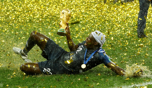 France's Benjamin Mendy celebrates with the trophy after winning the World Cup in Moscow, Russia, July 15, 2018. (Photo by Kai Pfaffenbach/Reuters)