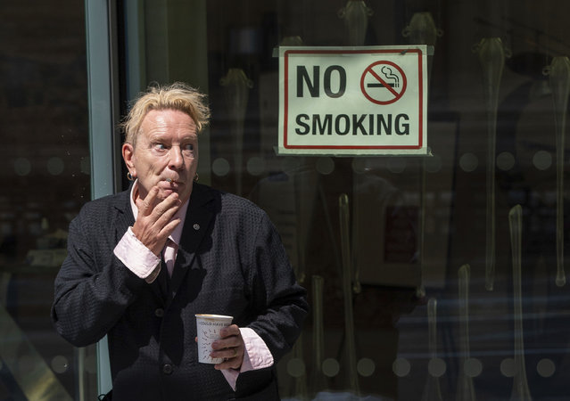 John Lydon, also known as Johnny Rotten (he is best known as the lead singer of the late-1970s British punk band the s*x Pistols), outside the Hight Court Rolls Building in London, where he is giving evidence in a hearing between two former s*x Pistols band members and the band frontman over the use of their songs in a television series, Wednesday July 21, 2021. Drummer Paul Cook and the band's former guitarist, Steve Jones, are suing the Pistols' former lead singer to allow their songs to be used in a TV series. (Photo by Dominic Lipinski/PA Wire via AP Photo)