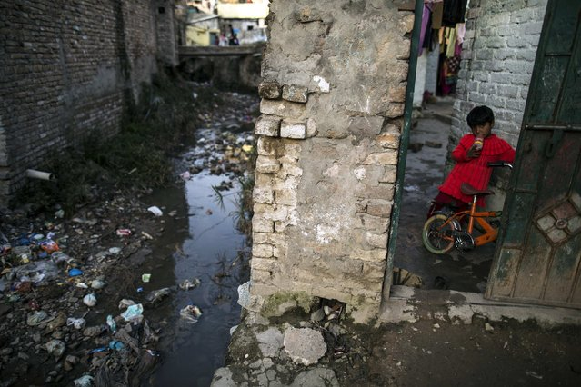 A girl stands inside her house at a slum in Islamabad March 12, 2015. (Photo by Zohra Bensemra/Reuters)