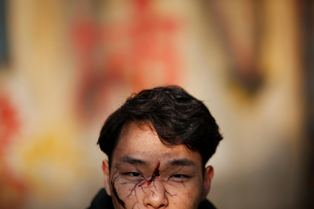 An actor waits for his scene at the set of the post-apocalyptic movie Zombie Era at an abandoned factory complex in Langfang, Hebei province, China December 16, 2016. (Photo by Damir Sagolj/Reuters)