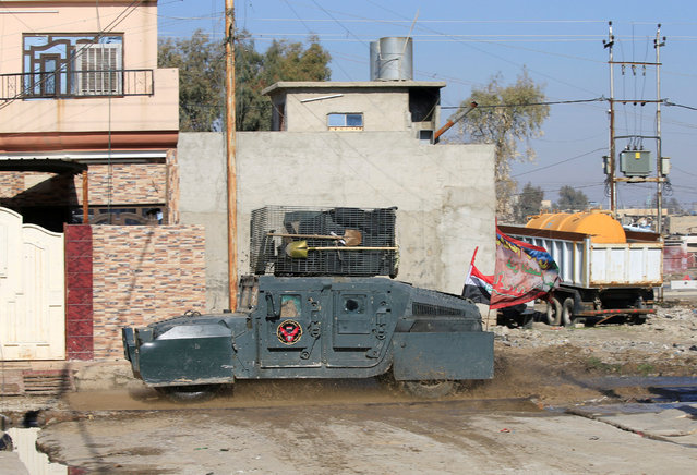 A military vehicle of the Iraqi special forces is seen during a battle with Islamic State militants in Wahda district of eastern Mosul, Iraq, January 6, 2017. (Photo by Alaa Al-Marjani/Reuters)