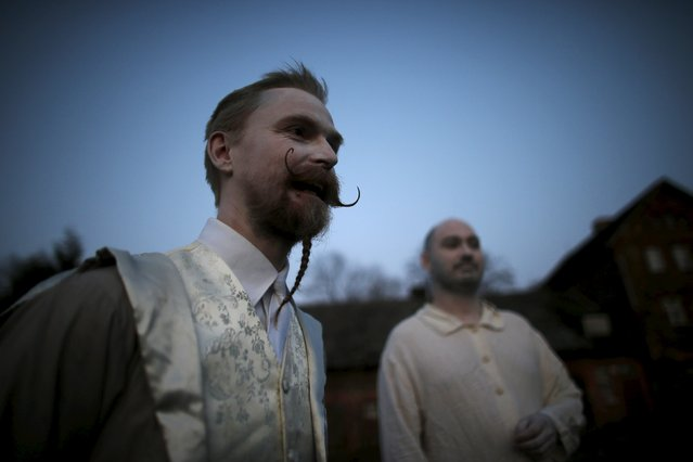 Participants chat as they wait for the beginning of the role play event at Czocha Castle in Sucha, west southern Poland April 9, 2015. (Photo by Kacper Pempel/Reuters)