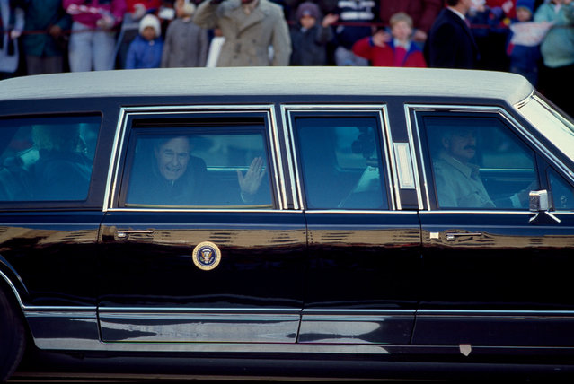 George H. W. Bush waves from the presidential limousine during his inaugural parade in Washington, D.C., U.S. in January 1989. (Photo by Reuters/Library of Congress)
