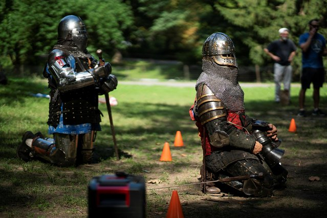 People in full medieval armor get ready to take part in a combat at Central Park in New York, U.S., August 14, 2021. (Photo by Eduardo Munoz/Reuters)