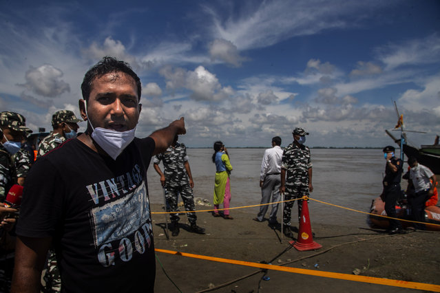 Shantanu Bora, asks authorities to look for his missing relative Vikramjit Baruah after two passenger ferries collided Wednesday in the river Brahmaputra, near Nimati Ghat, in Jorhat, northeastern Assam state, India, Thursday, September 9, 2021. (Photo by Anupam Nath/AP Photo)