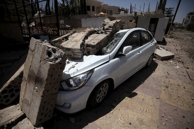 A car damaged by an air strike on Monday that hit a nearby army weapons depot, is seen in Sanaa April 21, 2015. (Photo by Mohamed al-Sayaghi/Reuters)