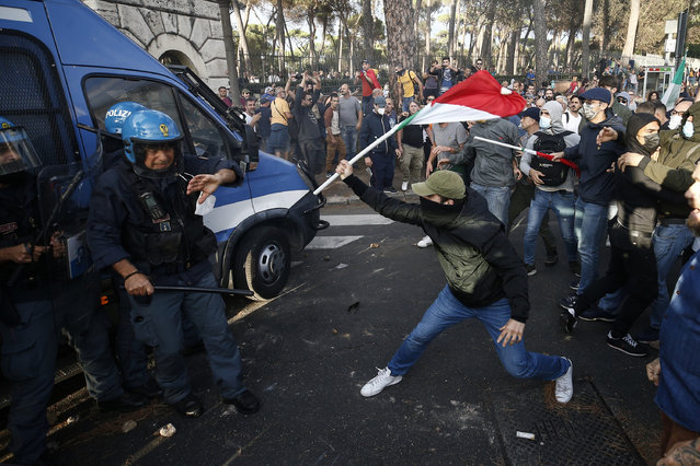 Police clashes with demonstrators during a protest, in Rome, Saturday, October 9, 2021. (Photo by Cecilia Fabiano/LaPresse via AP Photo)