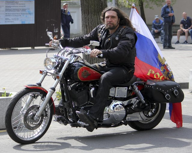 Night Wolves biker group leader Alexander Zaldostanov arrives for his news conference in Brest, some 350km from Minsk, Belarus, Tuesday, April 28, 2015. The leader of a Russian nationalist motorcycle club whose members were refused entry into Poland said Tuesday they haven't abandoned their plans to ride to Berlin to commemorate the defeat of Nazi Germany 70 years ago. (Photo by Milana Kharytonava/AP Photo)