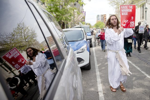"Mike Grant also known as ""Philly Jesus"" marches in May Day demonstration calling for a raise of the minimum wages to $15 an hour Friday, May 1, 2015, at a McDonald's restaurant in Philadelphia. Pennsylvania State Sen. Daylin Leach, D-Montgomery, is purposing legislation to increase the minimum wages to $15, index it to inflation, and eliminated the tipped minimum wage. (Photo by Matt Rourke/AP Photo)"