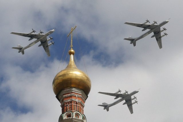 Russian Tu-95MS strategic bombers fly in formation during rehearsals for the Victory Day military parade, with St. Basil's Cathedral seen in the foreground, in central Moscow May 5, 2015. Russia will celebrate the 70th anniversary of the victory over Nazi Germany in World War Two on May 9. (Photo by Tatyana Makeyeva/Reuters)