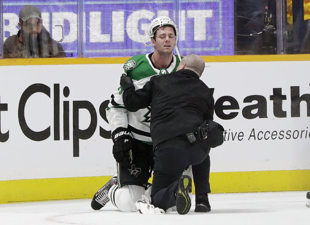 Dallas Stars center Jason Dickinson is attended to after being injured during the first period in Game 1 of the team's NHL hockey first-round playoff series against the Nashville Predators on Wednesday, April 10, 2019, in Nashville, Tenn. (Photo by Mark Humphrey/AP Photo)