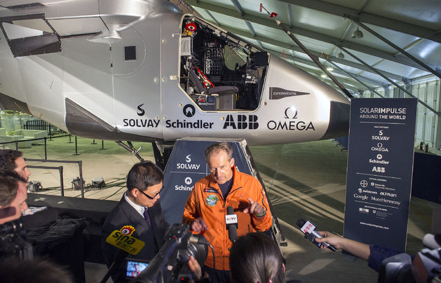 Swiss pilot Andre Boschberg speaks to journalists near the aircraft Solar Impulse 2 at the airport in Nanjing in east China's Jiangsu province Monday, May 4, 2015. Borschberg, 62, is due to fly over the Pacific Ocean for five days and five nights in the plane that has more than 17,000 solar cells on its wings to power its motors and recharge its batteries for nighttime flying. (Photo by Chinatopix via AP Photo)