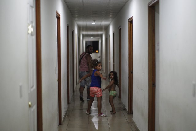 Cuban migrant children play in the hallway of an old hotel used as a provisional shelter in Paso Canoas, at the border with Costa Rica, in Panama March 21, 2016. (Photo by Carlos Jasso/Reuters)