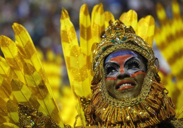 A reveller of the Beija-Flor samba school participates in the annual Carnival parade in Rio de Janeiro's Sambadrome, March 3, 2014. (Photo by Sergio Moraes/Reuters)