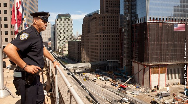 A Police officer looks over teh World Trade Center site from the tenth floor balcony of Two World Trade Center