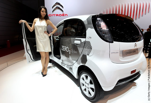 A model poses next to the Citroen C-Zero