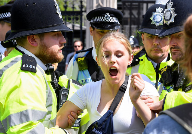 Police remove a climate change demonstrator during a march supported by Extinction Rebellion in London, Britain May 24, 2019. (Photo by Toby Melville/Reuters)