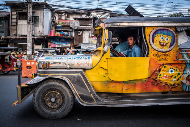 Manila is developing fast, and the jeepney is considered a dinosaur because of its old-fashioned look and diesel engine. (Photo by Claudio Sieber/Barcroft Media)