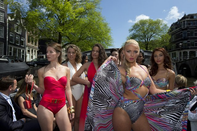 Models sport beachwear designed by Gottex during the Canal Catwalk fashion show with clothing dedicated to Kate, Duchess of Cambridge, during the first edition of the World Fashion Fair in Amsterdam, Netherlands, Thursday, May 21, 2015. (Photo by Peter Dejong/AP Photo)