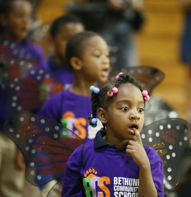 Kinyare Bell, a kindergartener at Bethune Elementary School, wears butterfly wings as she and her classmates performe during a talent assembly Monday May 18, 2015 in Minneapolis, Minn. (Photo by Jerry Holt/The Star Tribune via AP Photo)