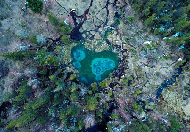 A view of Blue Geyser Lake near the village of Aktash in the Ulagan District, Altai Republic, Russia on June 3, 2019. (Photo by Yuri Smityuk/TASS)