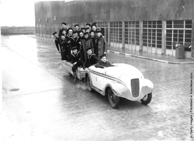 1940: Navy recruits riding in car and trailer at the HMS Royal Arthur training centre formerly Butlin's holiday camp, Skegness