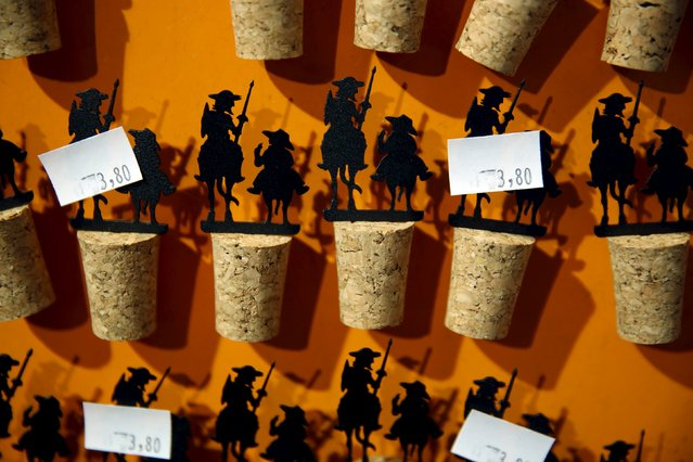 Don Quixote and Sancho Panza wine bottle corks are displayed for sale at the inn where locals believe Don Quixote might have been knighted in Puerto Lapice, Spain, April 8, 2016. (Photo by Susana Vera/Reuters)