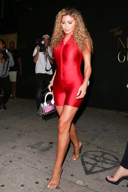 Larsa Pippen shows off her figure in a red spandex jumpsuit for a night out at The Nice Guy in West Hollywood, CA. on July 10, 2019. (Photo by Backgrid USA)