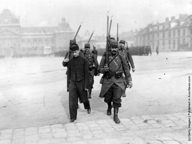 1914: A French traitor is led away to his death, by soldiers from the firing squad